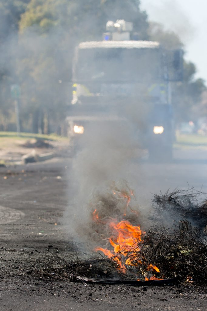 Protest Action with Burning Tyres in Road by Duncan J Noakes.
